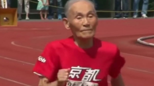Hidekichi Miyazaki imitates the pose of the Olympic champion Usain Bolt after competing in the Kyoto Masters competition in Kyoto. Miyazaki's time of 42.22 seconds earned him a place in Guinness World Records